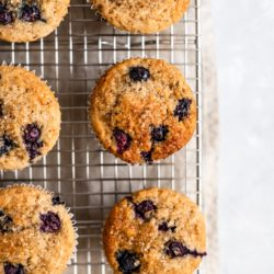 Buttermilk Blueberry Muffins on a wire cooling rack