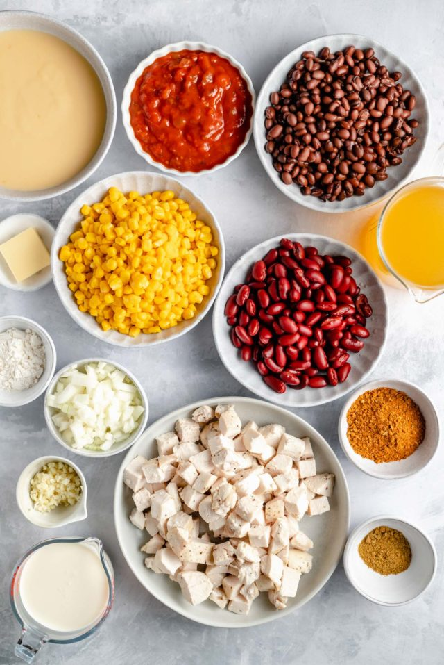 ingredients for chicken tortilla soup separated in small white bowls