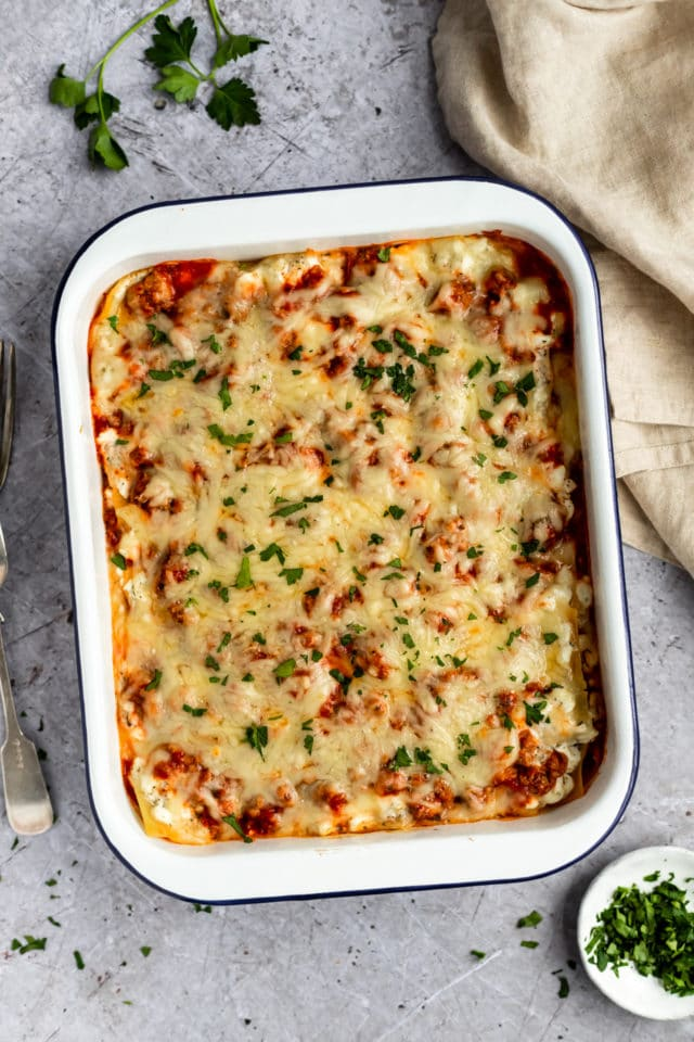 baked easy healthy lasagna in a white casserole dish