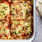 easy healthy lasagna cut into large squares for serving
