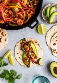 making shrimp fajitas with avocado and lime