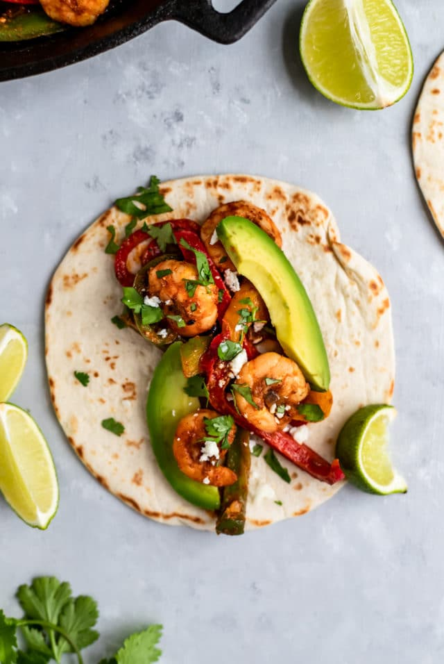 shrimp fajita topped with avocado slices