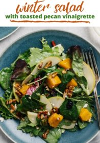 making a winter salad with roasted butternut squash and toasted pecans