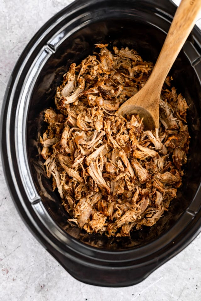 pulled pork cooking in a slow cooker