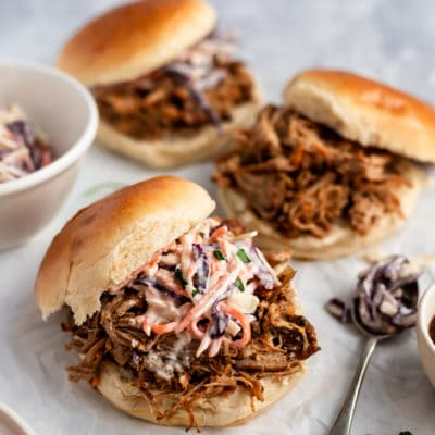 pulled pork sandwiches topped with creamy coleslaw