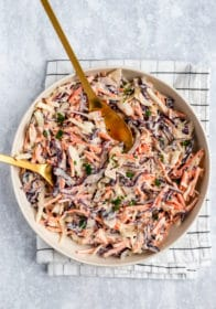 a white bowl filled with the best coleslaw recipe