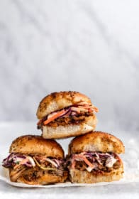 sliders filled with pulled pork and coleslaw