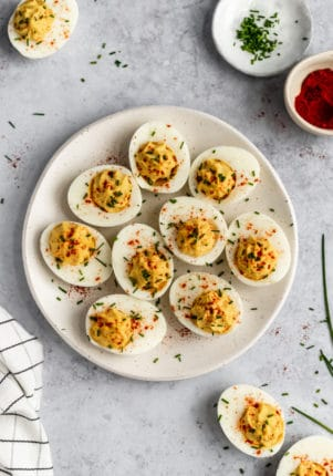 deviled eggs served on a white plate