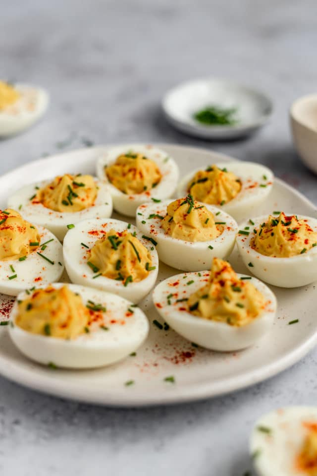 deviled eggs on a white serving tray