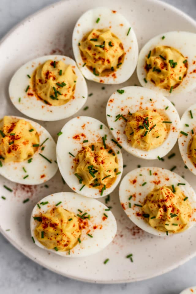 the best deviled eggs topped with chives and smoked paprika
