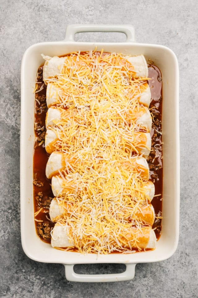 rolled up beef enchiladas in a baking dish