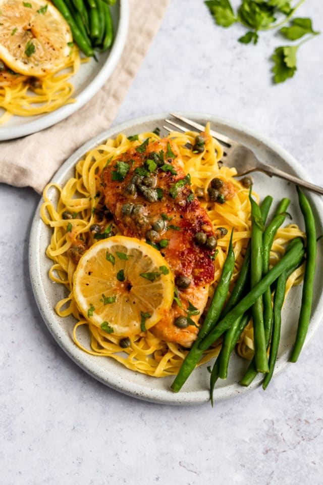 Chicken Piccata Recipe served over pasta with green beans