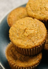 carrot muffins stacked on a blue plate