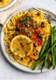 chicken dish served with pasta and green beans