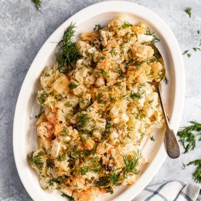 potato salad on a large white serving platter