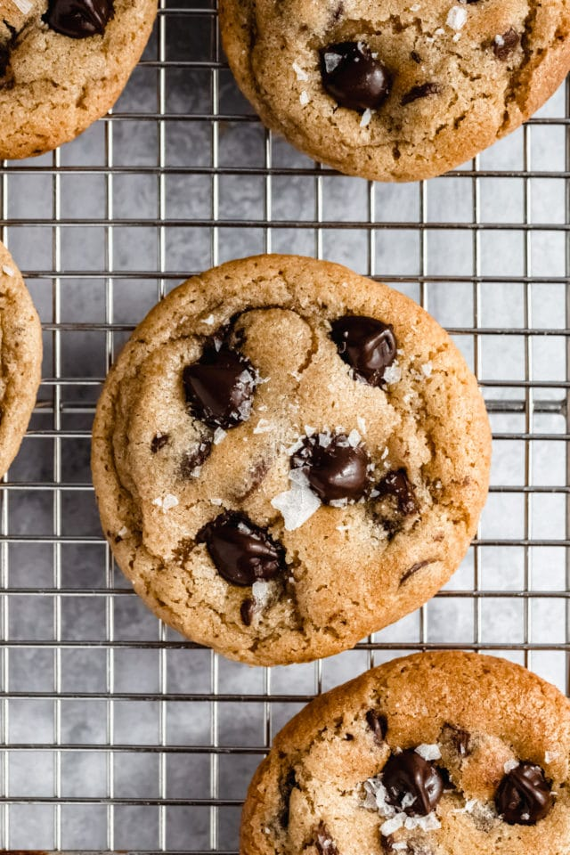 sea salted chocolate chip cookie on a wire cooling rack