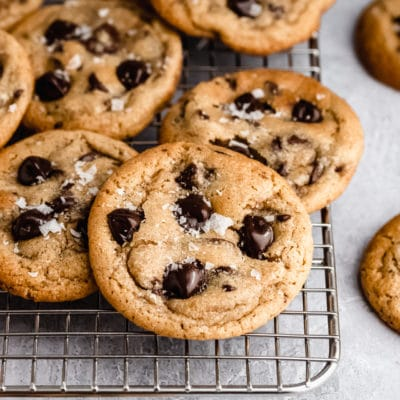 chewy chocolate chip cookies stacked on a wire cooling rack