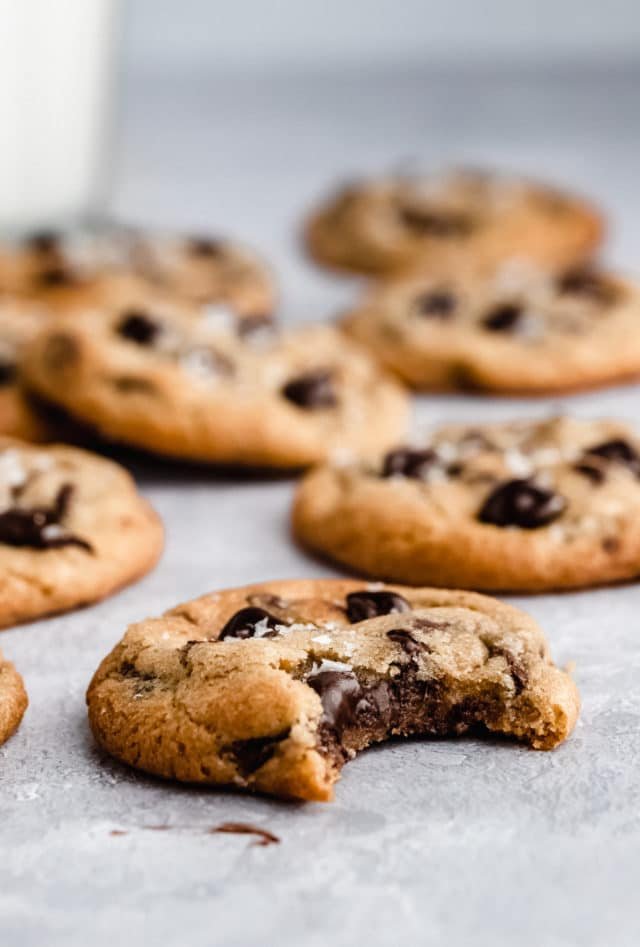 chewy chocolate chip cookies with a bite out of one