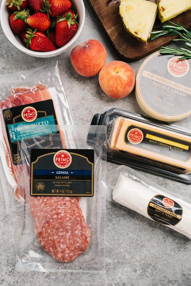 ingredients for adding to a charcuterie board, like prosciutto, salami and cheese