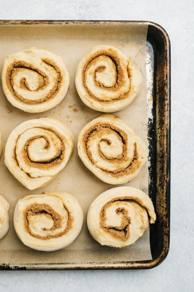 place cinnamon rolls on a large rimmed baking sheet lined with parchment paper