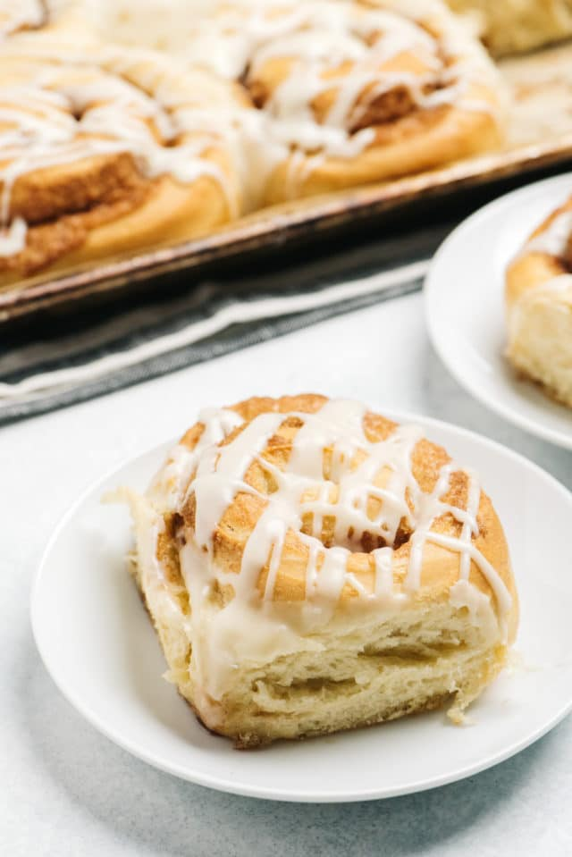 homemade cinnamon rolls served on white plates