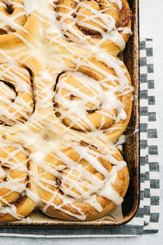 baking sheet pan with frosted cinnamon rolls