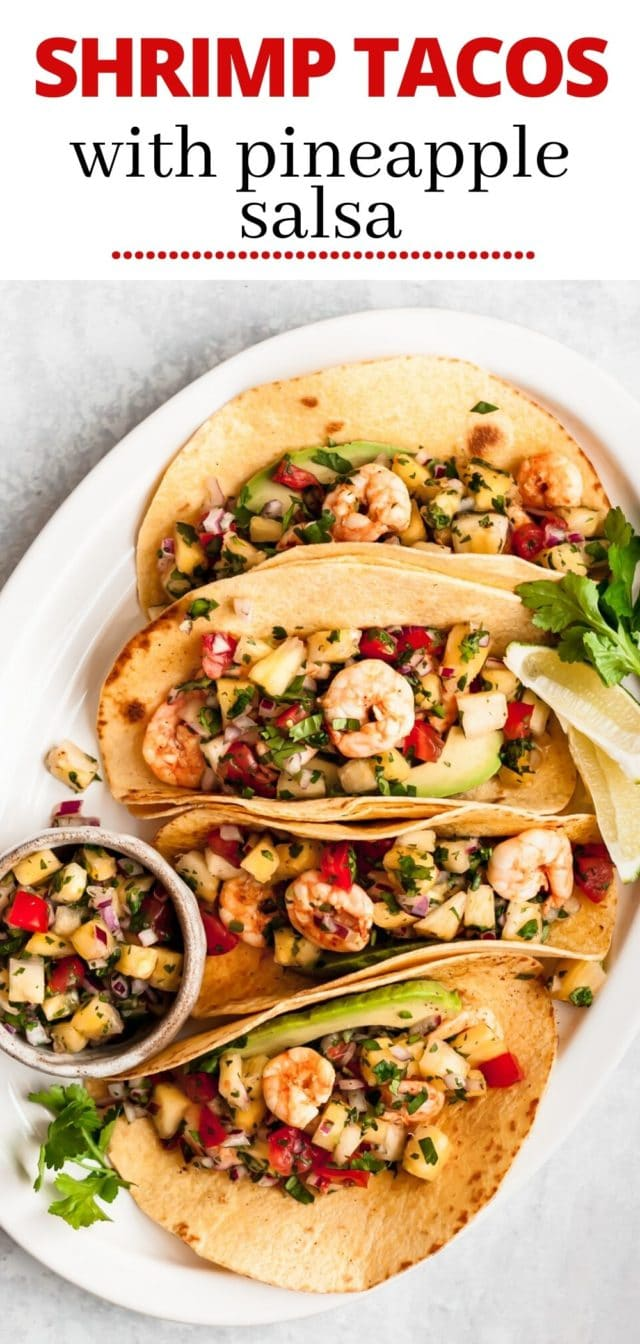 shrimp tacos on a platter with salsa