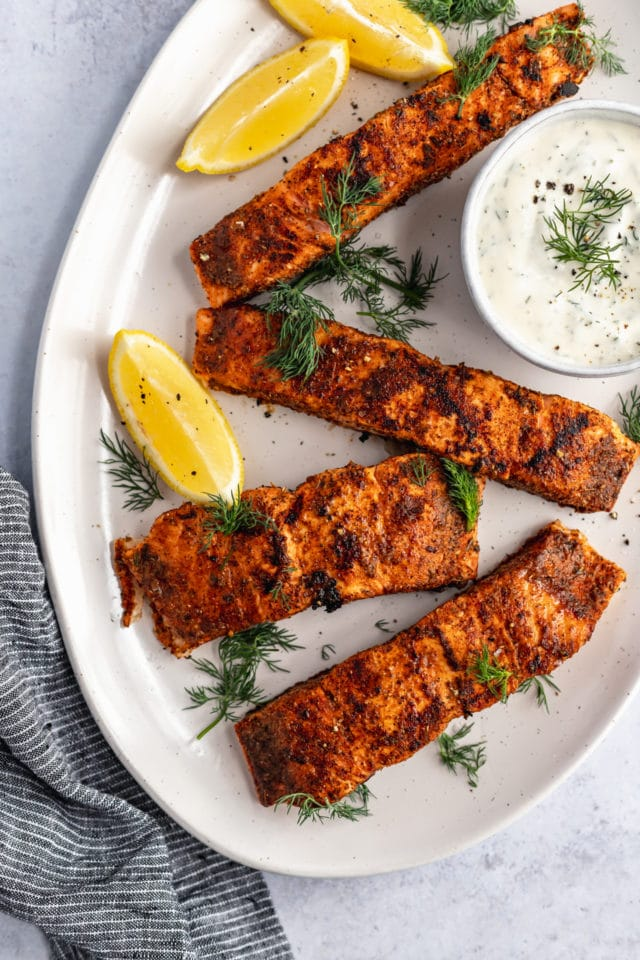 grilled salmon on a white serving plate