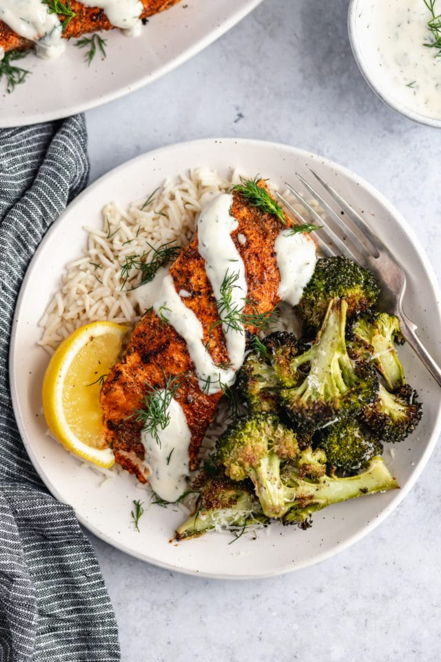 grilled salmon served with rice and roasted broccoli