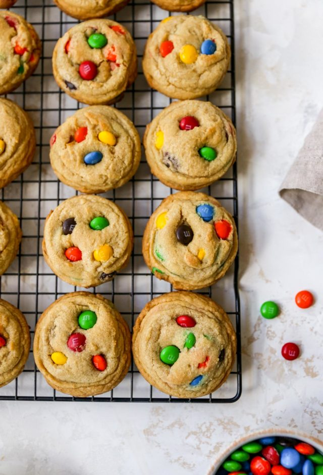 M&M cookies on a wire cooling rack