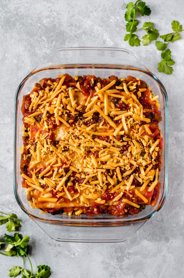 taco casserole in a glass dish ready to be baked