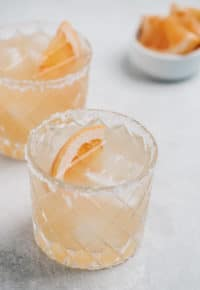 paloma cocktail with grapefruit slice and salt around the rim