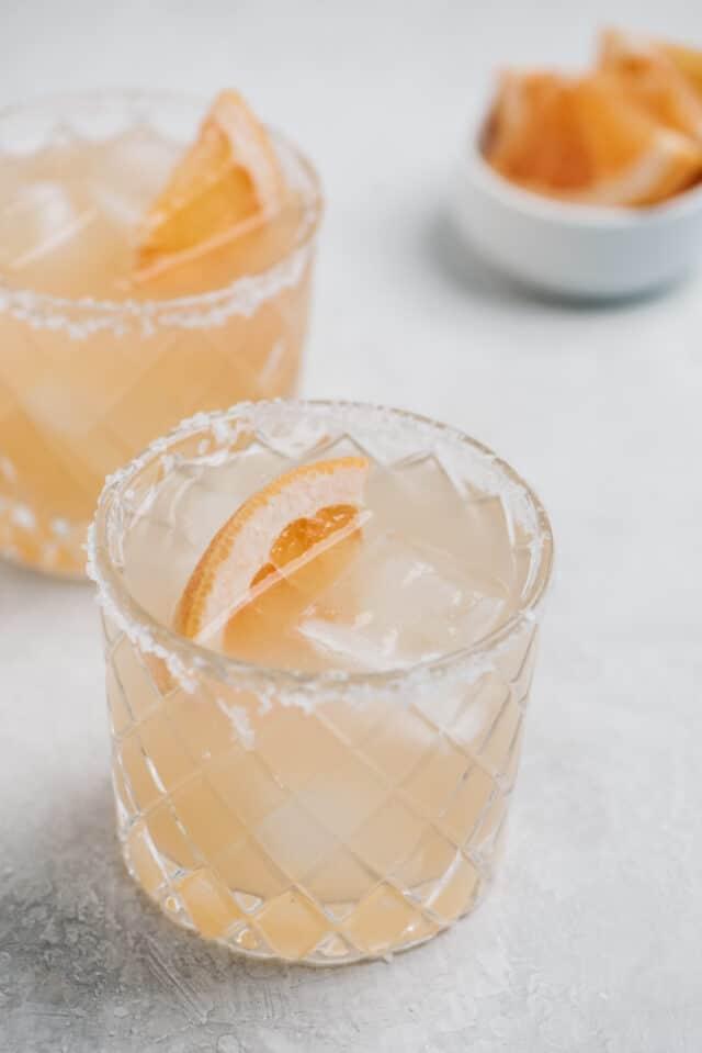paloma cocktail with grapefruit slice and salt around the rim