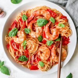 Pasta Pomodoro served with shrimp and fresh basil