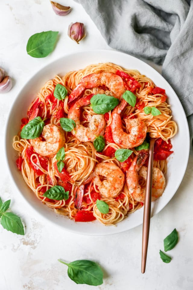 Pasta Pomodoro served with shrimp and fresh basil