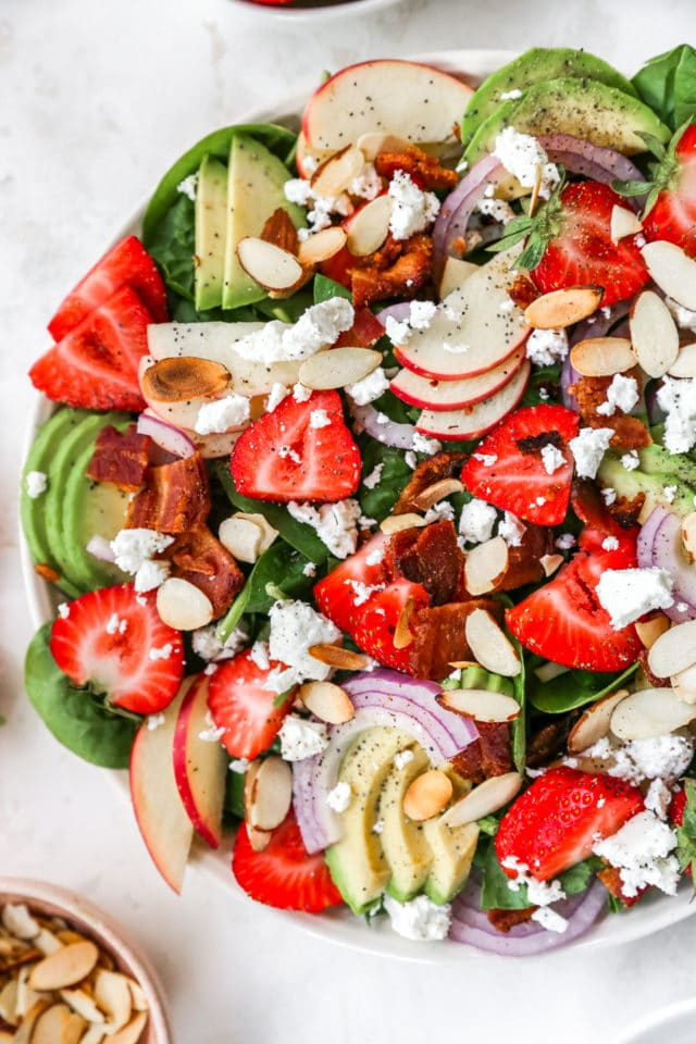 Spinach Strawberry Salad made with avocado, apple, and bacon