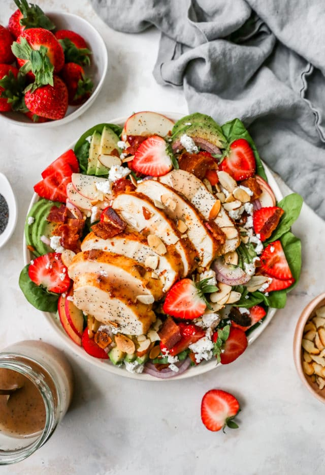 Spinach Strawberry Salad served with baked chicken and poppy seed dressing