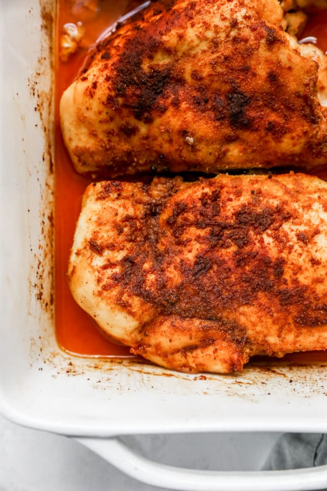 baked seasoned chicken in a white dish