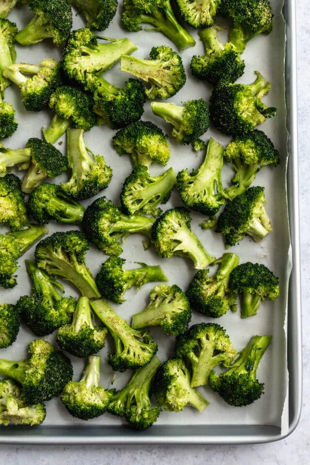 fresh broccoli on a baking sheet