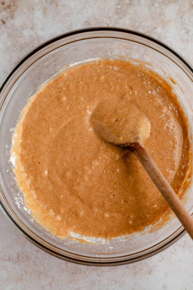 mixing batter for pumpkin waffles