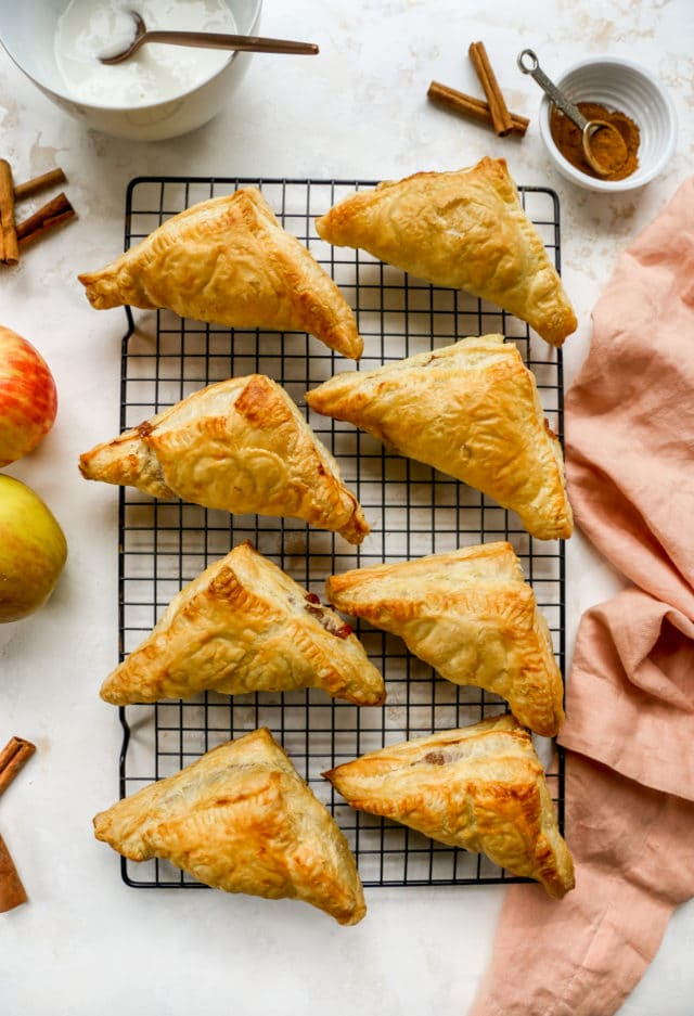 baked apple turnovers on a wire cooling rack