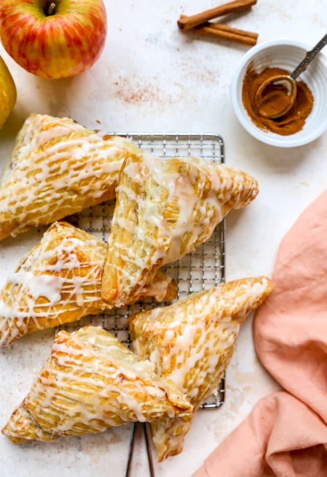 apple turnovers topped with glaze