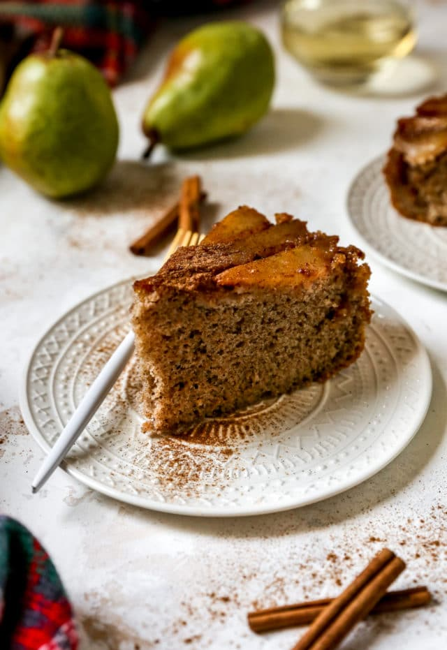 piece of spice pear cake on a small white plate