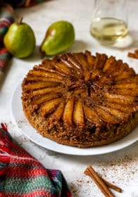 upside down pear cake on a white serving platter
