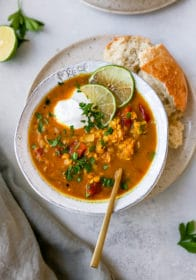 red lentil soup served with crusty bread