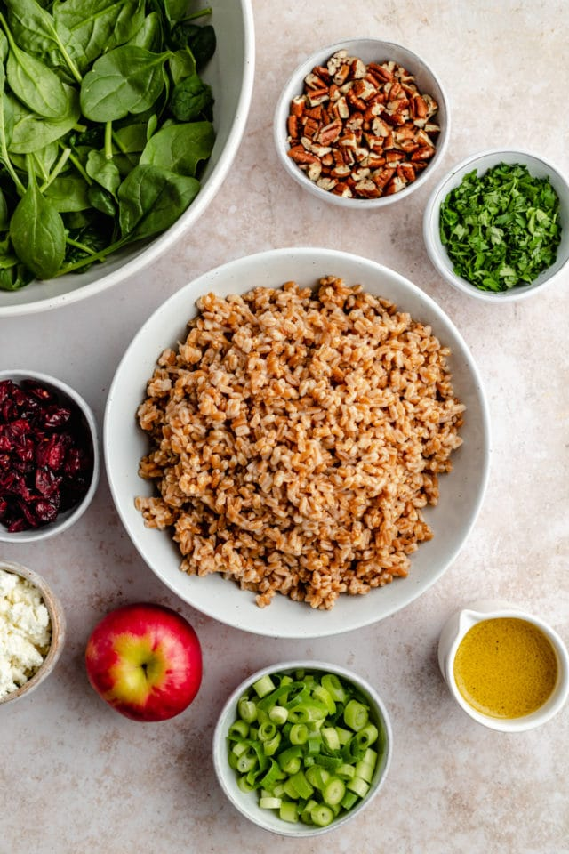 ingredients for farro salad in small bowls