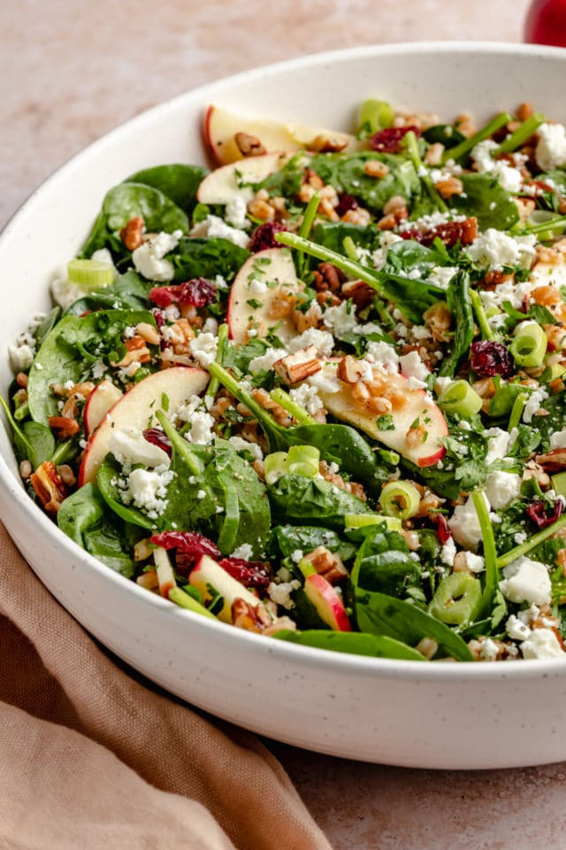 farro salad made with apple slices, spinach and feta cheese