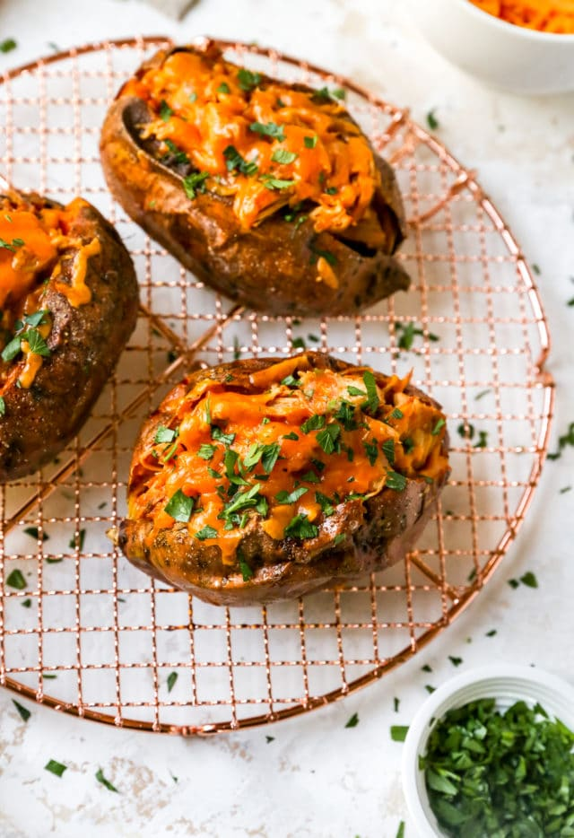 crockpot BBQ chicken stuffed in a sweet potato and topped with cheese