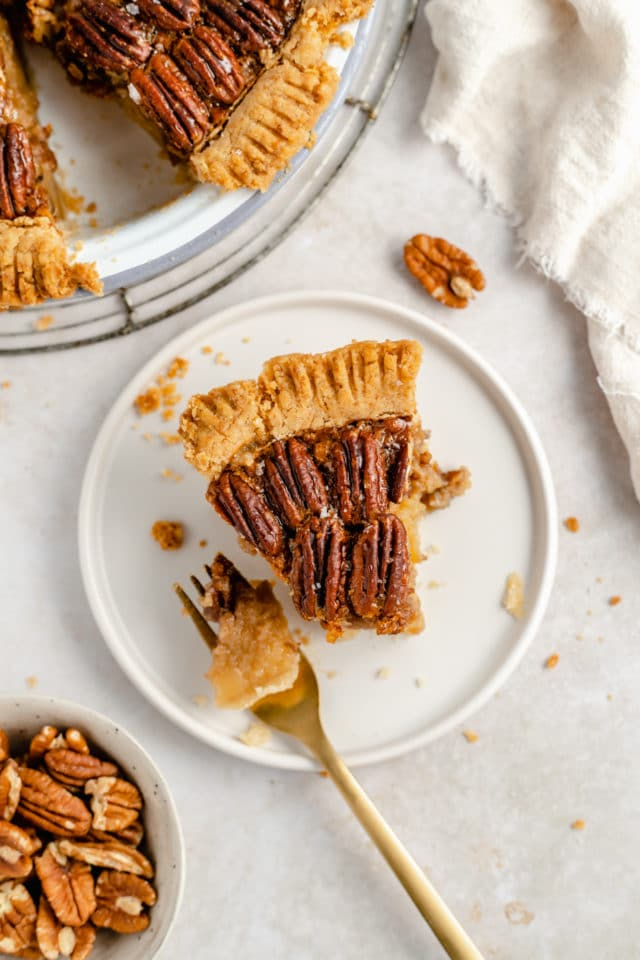 slice of pecan pie with a bite taken out