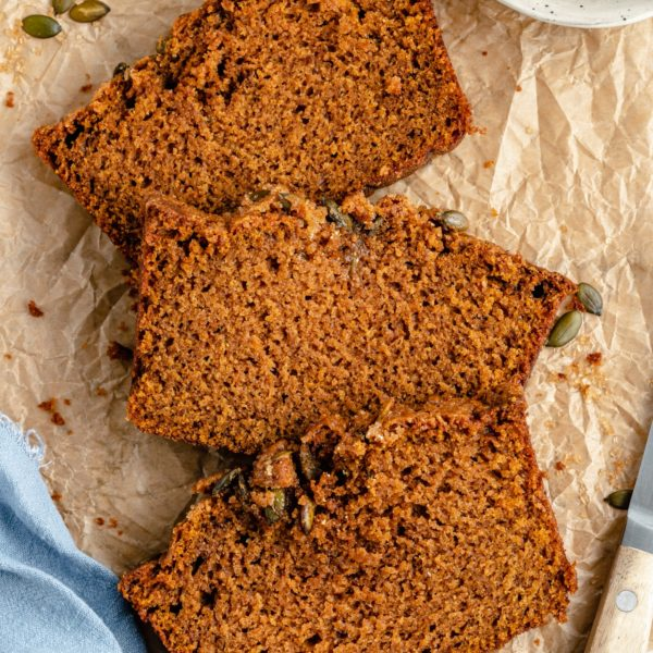 slices of pumpkin bread on parchment paper